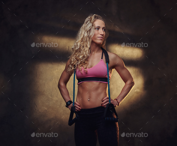 Portrait of pretty blond woman in sport suit - Stock Photo - Images