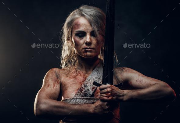 Naked Fantasy woman warrior wearing rag cloth - Stock Photo - Images