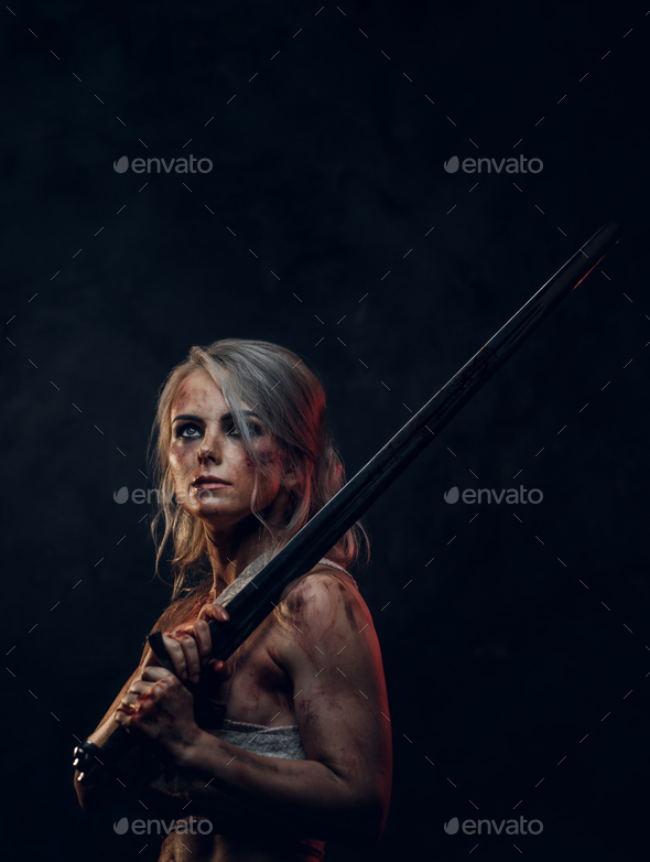 Naked fantasy woman warrior wearing rag cloth stained with blood and mud - Stock Photo - Images