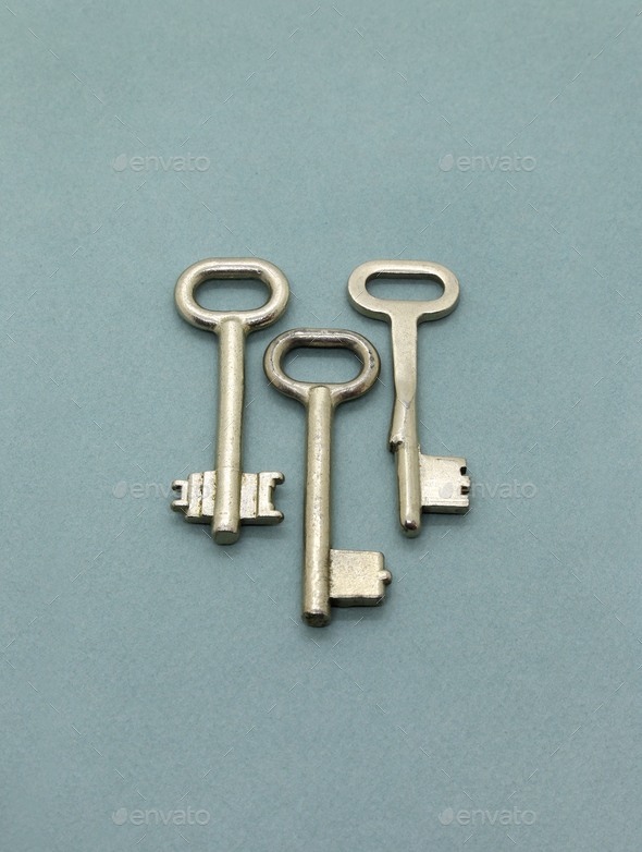 Several old metal keys on green background - Stock Photo - Images