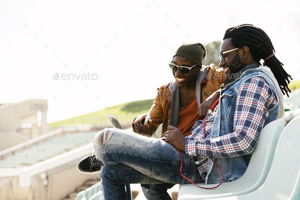 Two black race friends having fun with laptop. - Stock Photo - Images