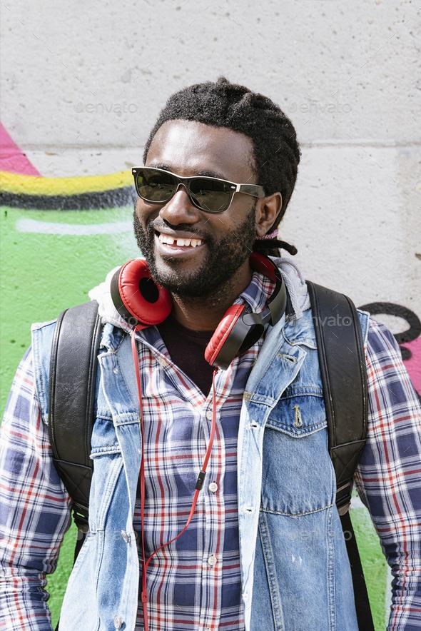 Portrait of a black man smiling. - Stock Photo - Images
