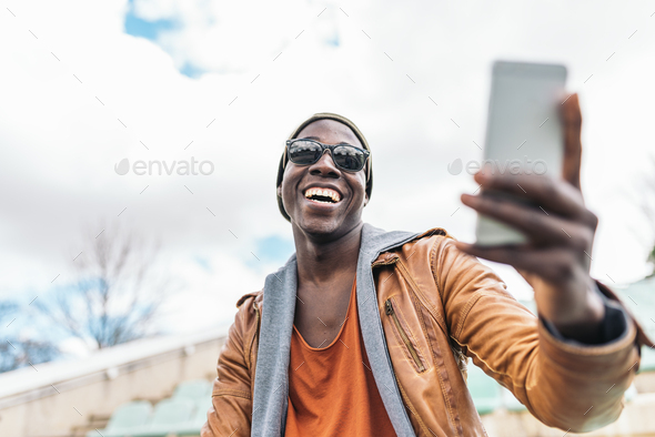 American man using mobile in the street. - Stock Photo - Images