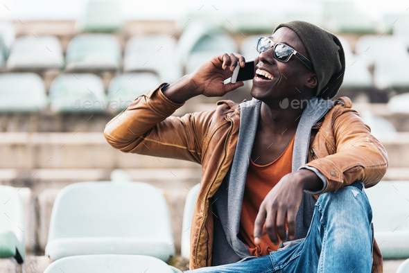 American man using mobile. - Stock Photo - Images