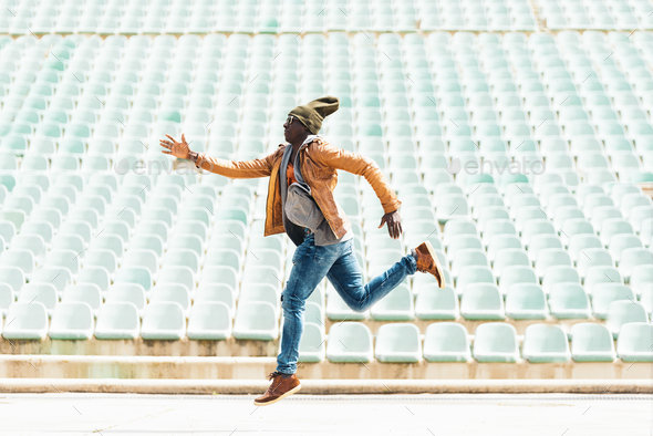 American man jumping in the park. - Stock Photo - Images