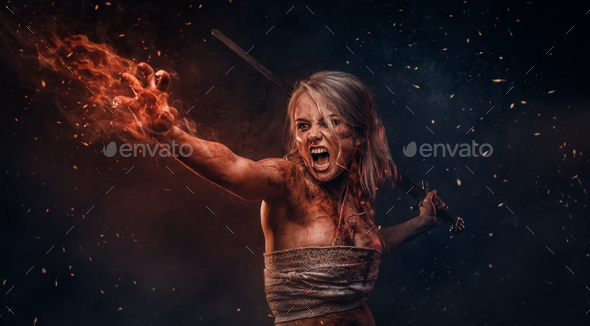 Fantasy woman warrior wearing rag cloth stained with blood and mud in the heat of battle - Stock Photo - Images