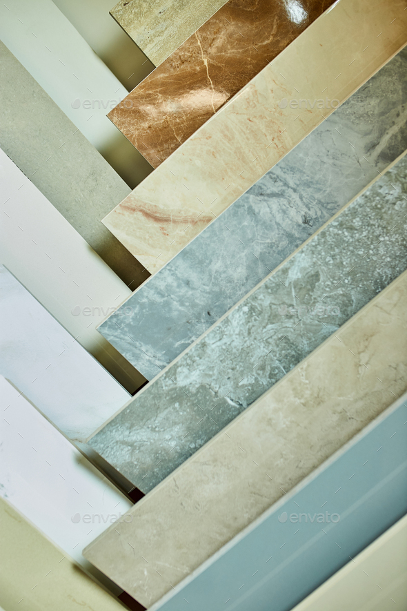 Various decorative tiles samples. Colorful samples of a stone tile in store - Stock Photo - Images