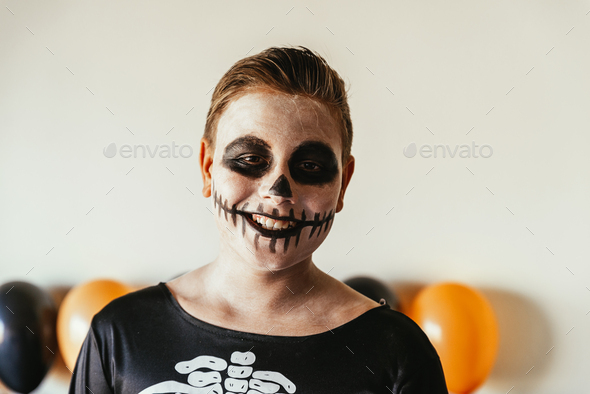 Portrait of boy disguised of skeleton at home. - Stock Photo - Images
