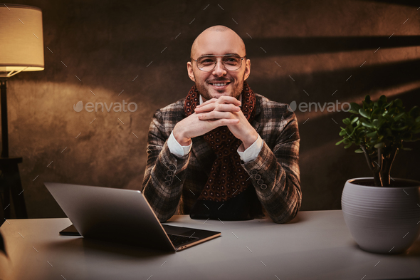 Confident european handsome businessman sitting in the office - Stock Photo - Images