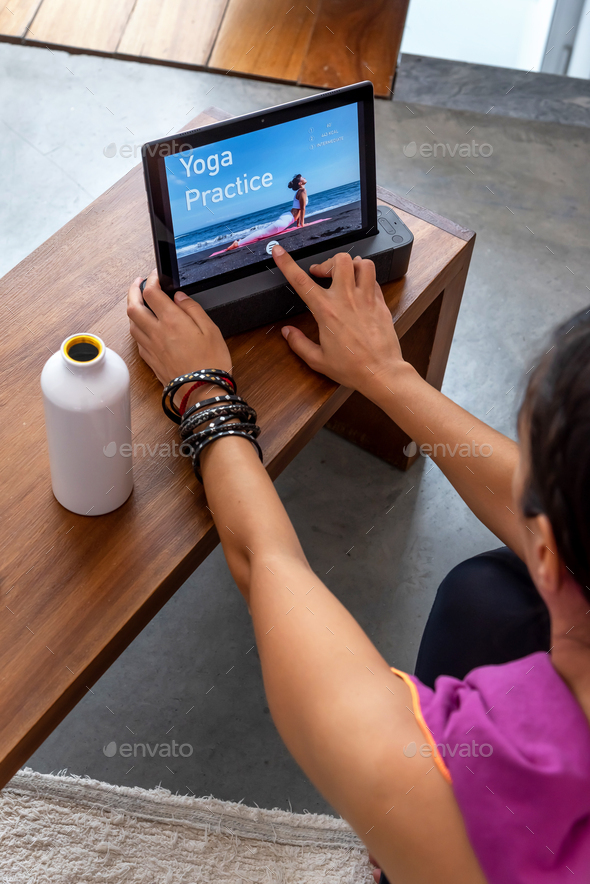 Woman finishing her online yoga session at home - Stock Photo - Images