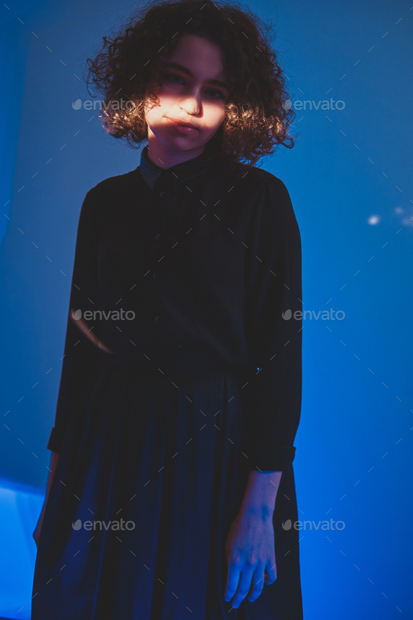 Curly woman with stripe of light on the face - Stock Photo - Images