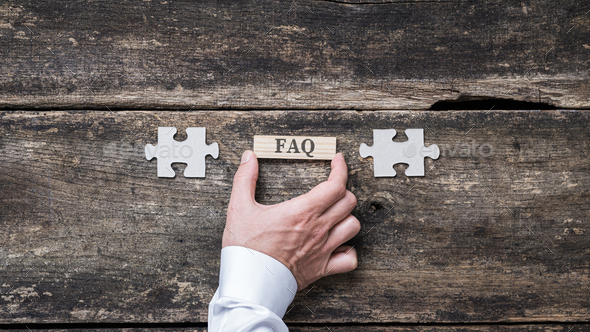FAQ sign on wooden peg - Stock Photo - Images