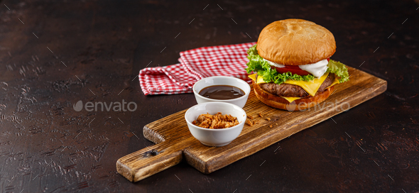 Close-up of home made tasty burger on wooden table. - Stock Photo - Images