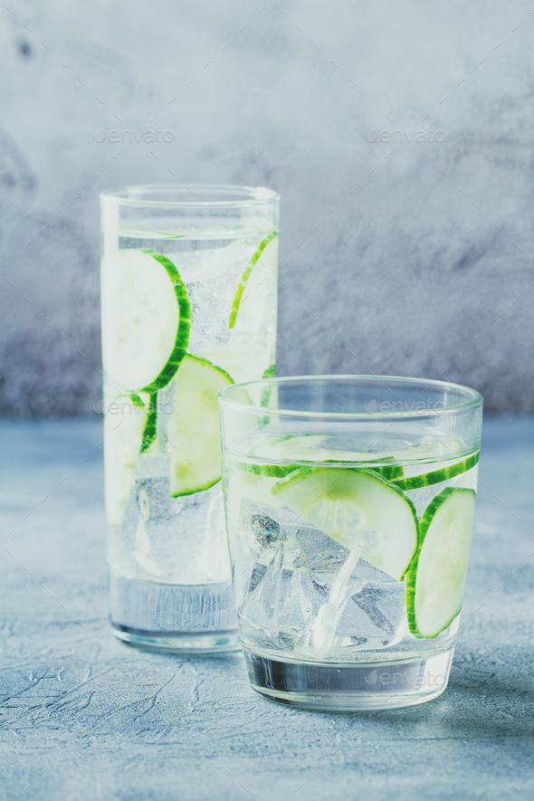 Infused water with cucumber and ice - Stock Photo - Images