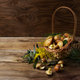 Wicker basket with forest mushrooms on the rustic background. - PhotoDune Item for Sale