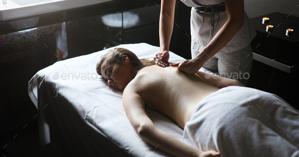 Masseur doing massage on woman body in the spa salon. Beauty treatment concept - Stock Photo - Images