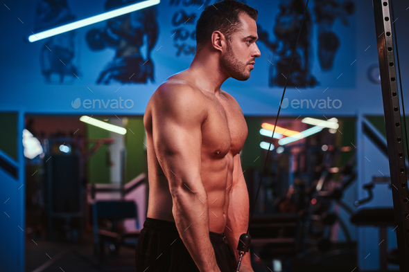 Shirtless bodybuilder in a modern fitness club - Stock Photo - Images