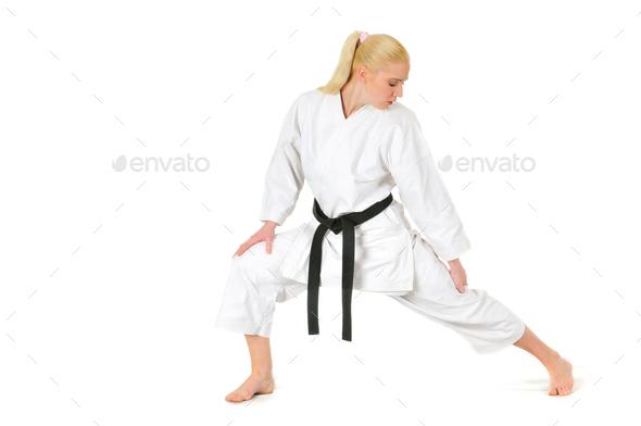 Girl blonde karate sportswoman in a kimono - Stock Photo - Images