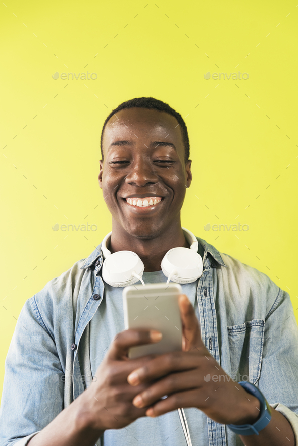 Handsome african man using mobile. - Stock Photo - Images