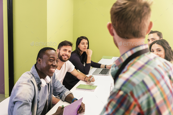 Teacher explaining the lesson to his students. - Stock Photo - Images