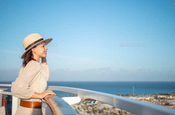 Smiling tourist looking at the view - Stock Photo - Images