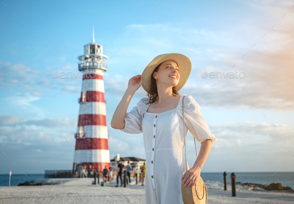 Smiling woman on the background of a beacon - Stock Photo - Images