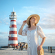 Smiling woman on the background of a beacon - PhotoDune Item for Sale