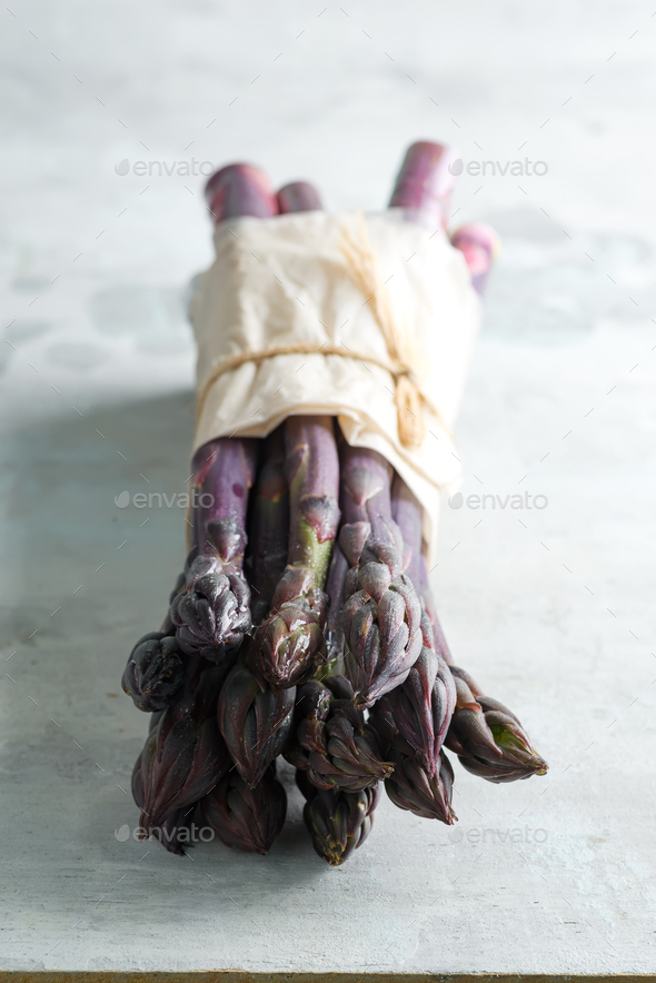 Home grown fresh natural organic purple asparagus bunch against stone background - Stock Photo - Images