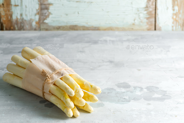 Organic food. Healthy food cooking concept. Uncooked Freshly picked raw organic white asparagus - Stock Photo - Images