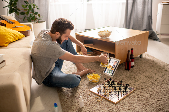 Drinking beer and playing chess - Stock Photo - Images