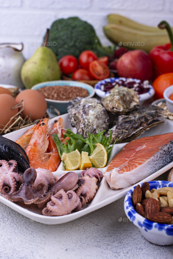 Pescetarian diet with seafood, fruit and vegetables - Stock Photo - Images