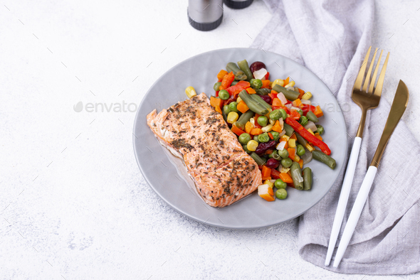 Baked salmon with boiled vegetable - Stock Photo - Images