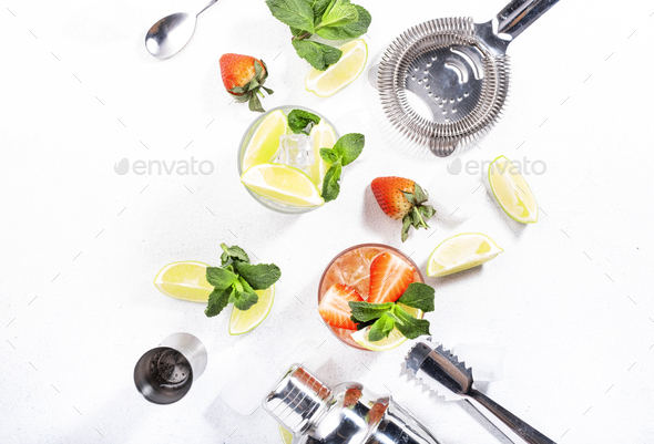 Fresh Mojito cocktail set with lime, mint, strawberry and ice in glass - Stock Photo - Images