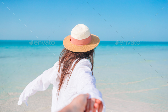 Woman laying on the beach enjoying summer holidays - Stock Photo - Images