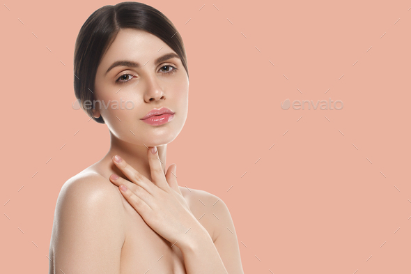 Beauty woman over pink background healthy skin - Stock Photo - Images