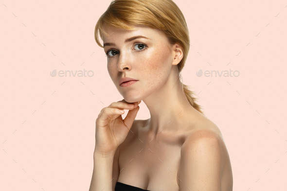 Beauty womanred hair beauty pink background - Stock Photo - Images