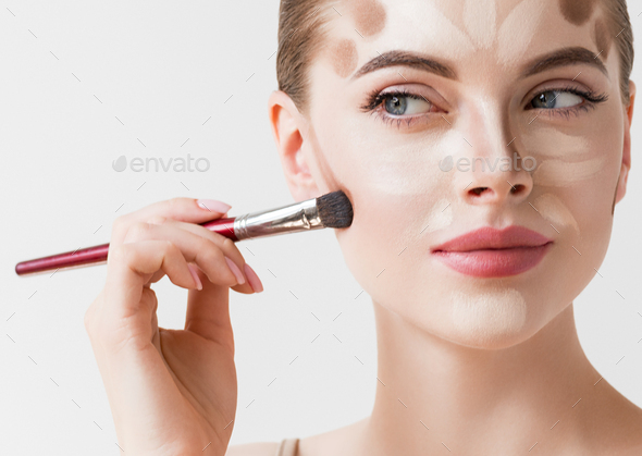 Make up woman face cosmetic applying - Stock Photo - Images