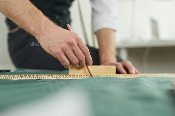 Designer cutting out the fabric - Stock Photo - Images