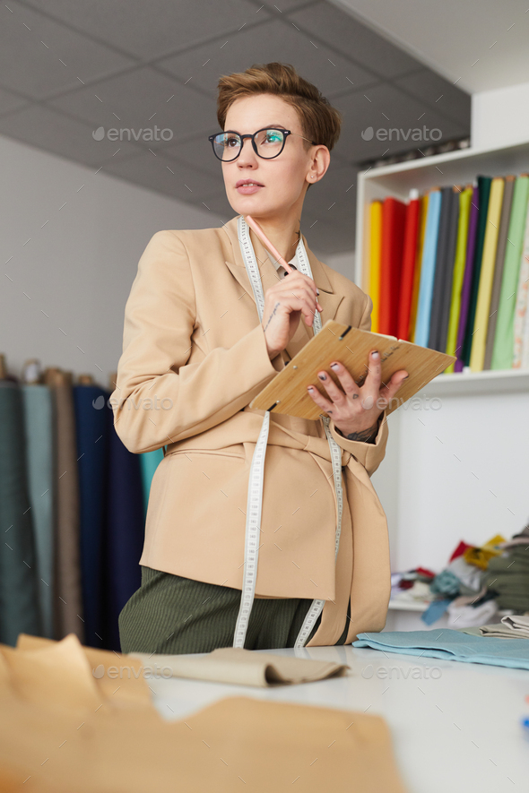 Tailor planning her work - Stock Photo - Images