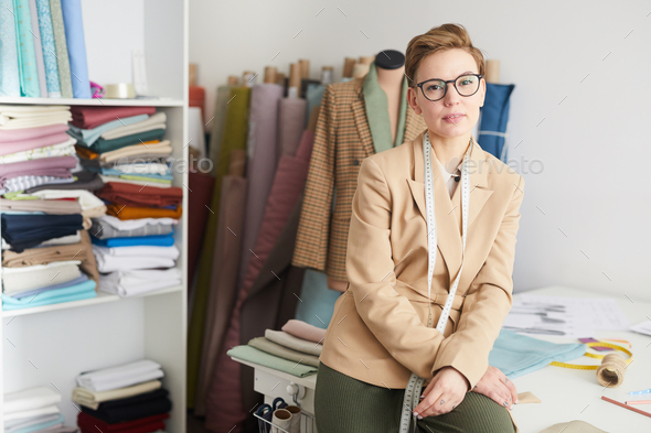 Female tailor in workshop - Stock Photo - Images