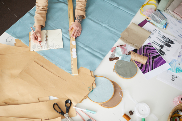 Designer sewing clothes - Stock Photo - Images
