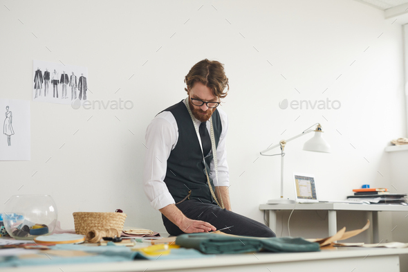 Designer working in the workshop - Stock Photo - Images