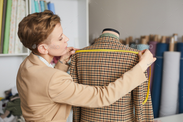 Tailor measuring the jacket - Stock Photo - Images