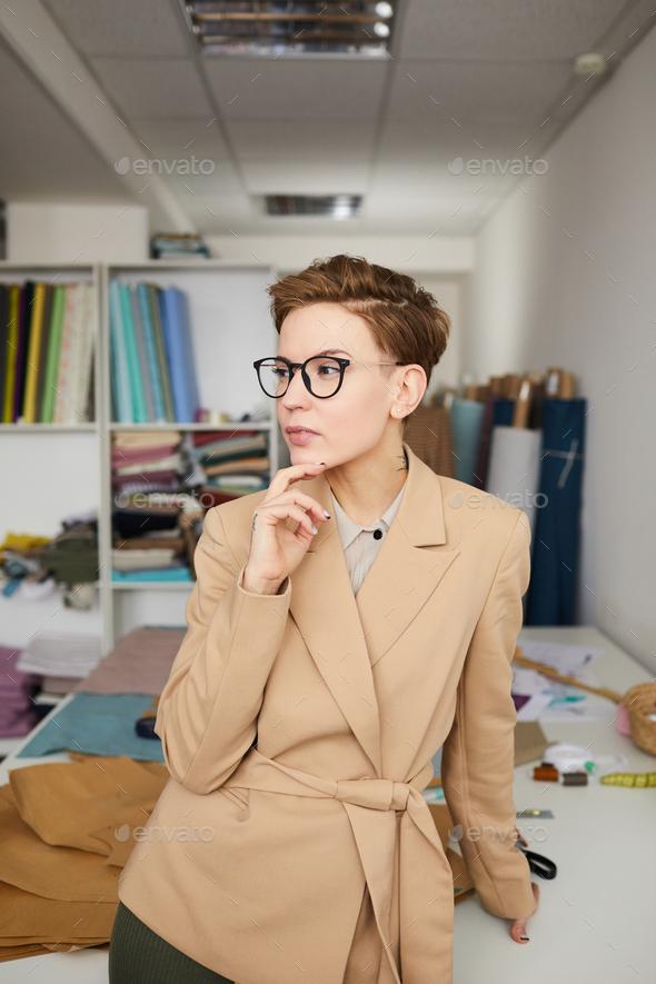 Fashion designer at workshop - Stock Photo - Images