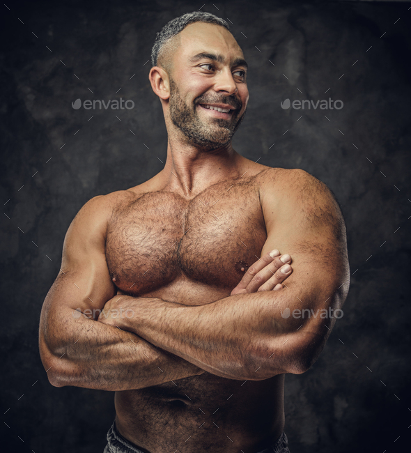 Adult caucasian muscular bodybuilder in a studio - Stock Photo - Images