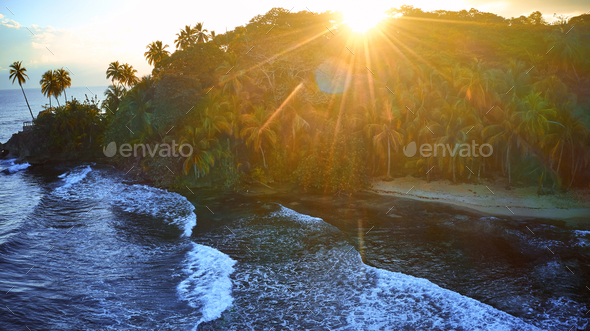 Aerial view of a tropical coast. Ocean scenery surrounded by palm trees on a beach with white sand - Stock Photo - Images