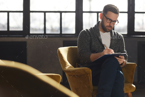 Man writing in document - Stock Photo - Images