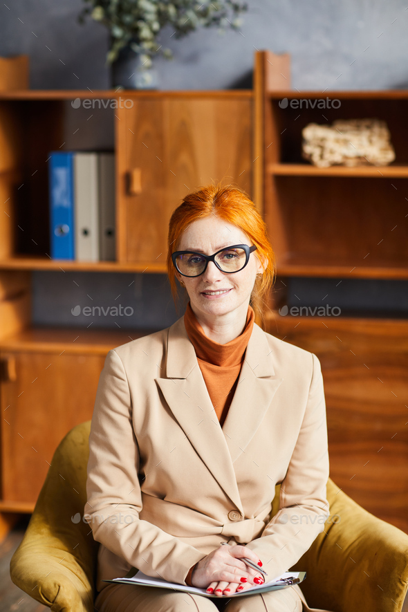 Mature businesswoman at the work - Stock Photo - Images