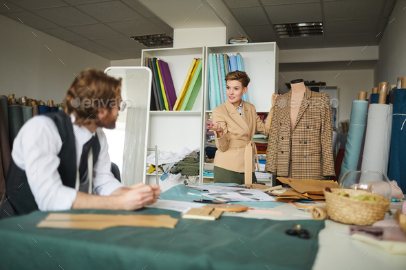 Designers discussing new jacket - Stock Photo - Images