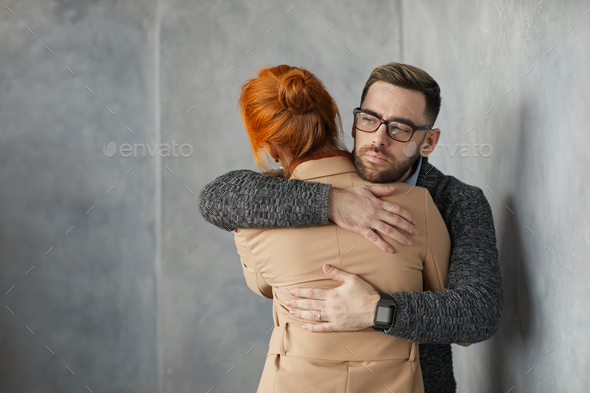 Young couple supporting each other - Stock Photo - Images